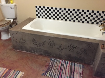 The tub had carvings around it!